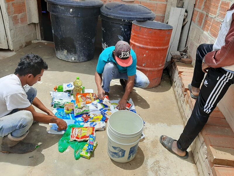 Family in a community on the outskirts of Bogota, Colombia receiving groceries